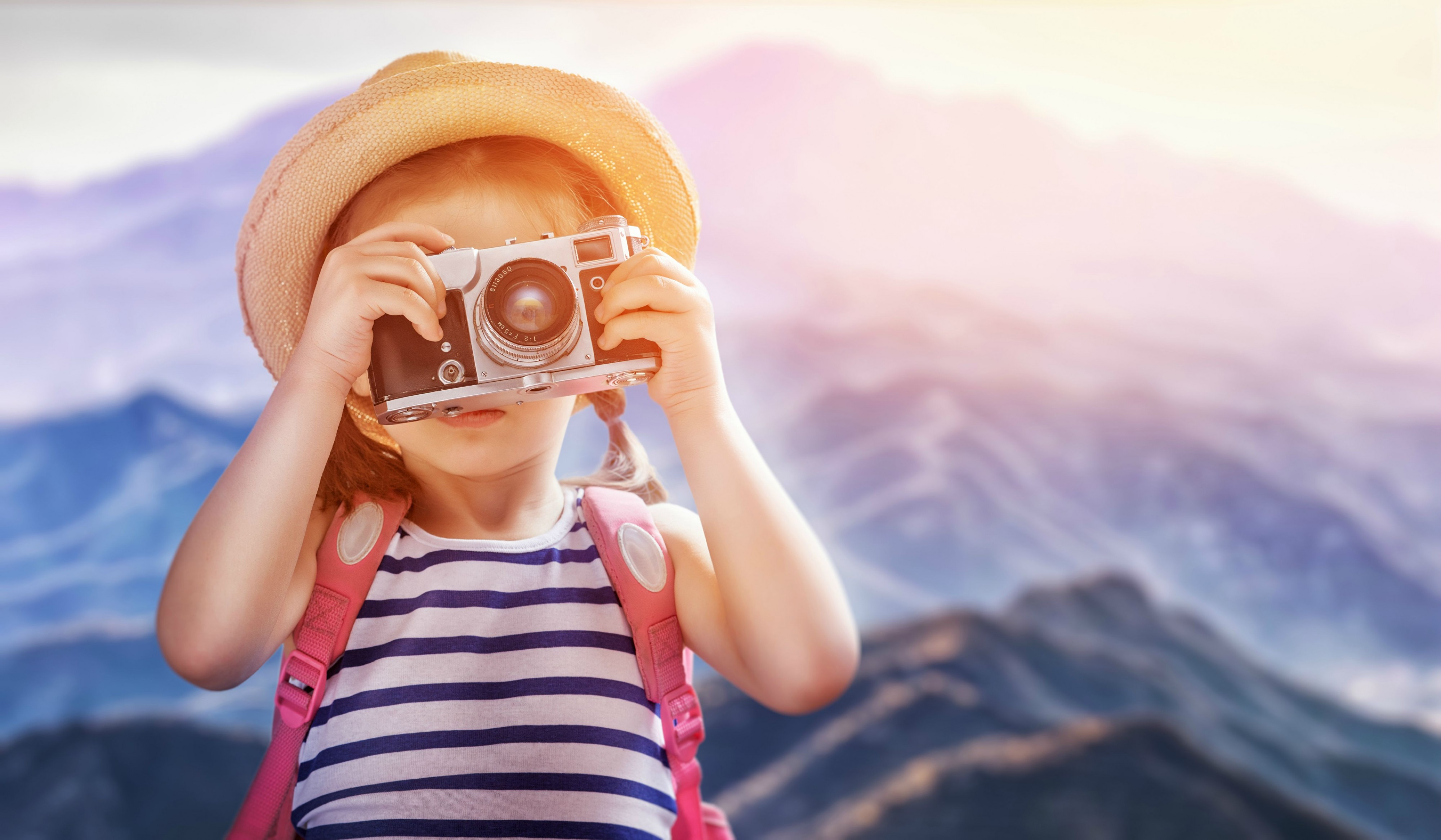 this is an image of a young girl with a camera