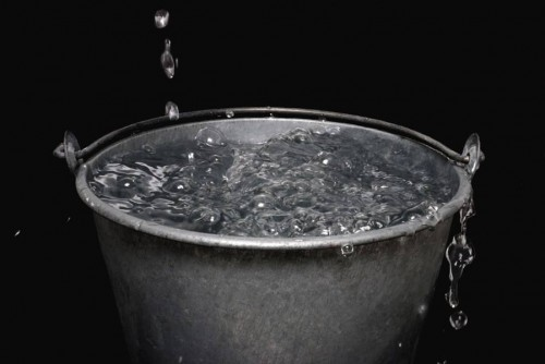 image of water dripping into a bucket