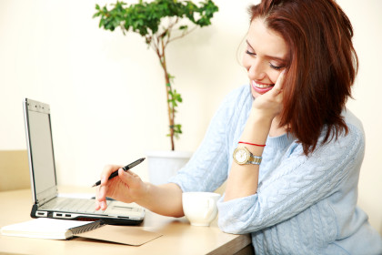 Cheerful woman working at home