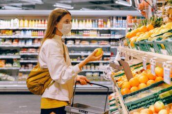 Lady wearing mask buying fruit