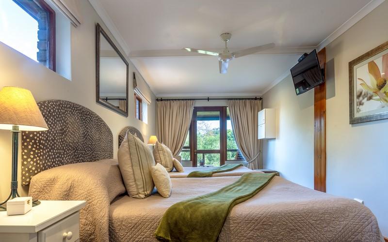 photo of bedroom at pumula lodge
