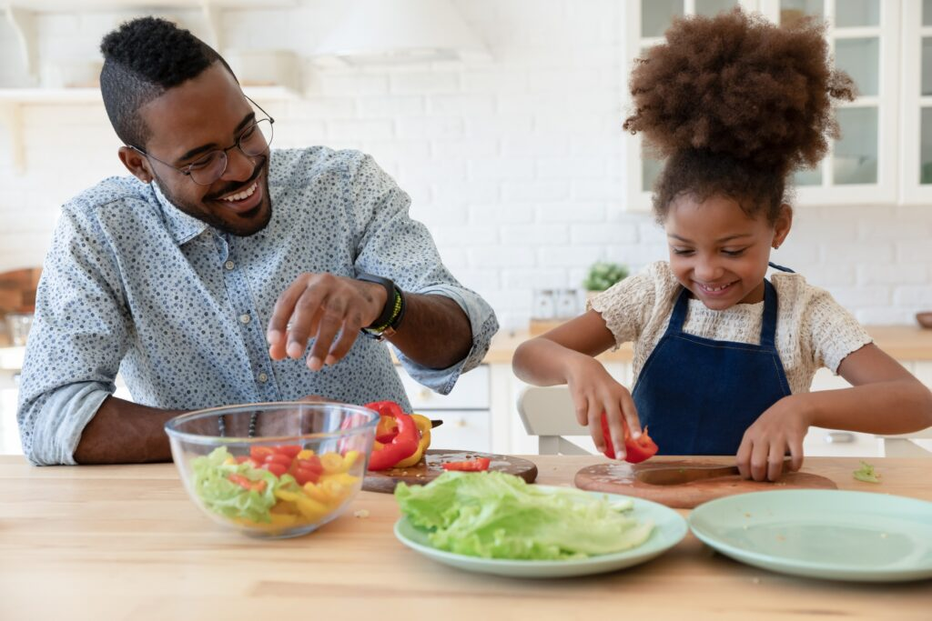 photo of father and daughter with healthy meal