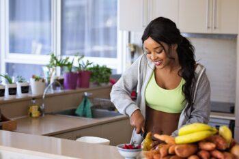 photo of lady cutting fruit