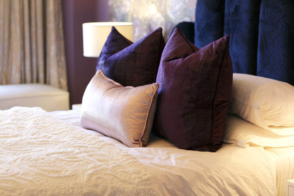 Photo of bed with cushions