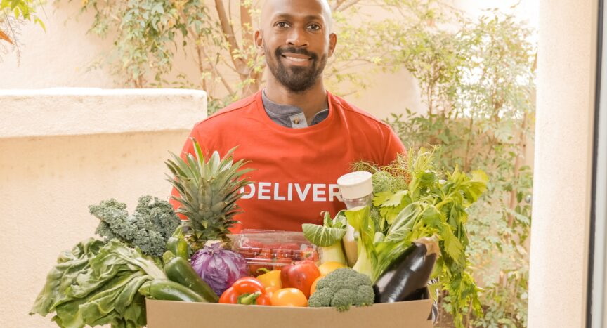 Man with boxes of vegetables