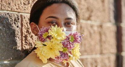 Lady wearing flower mask